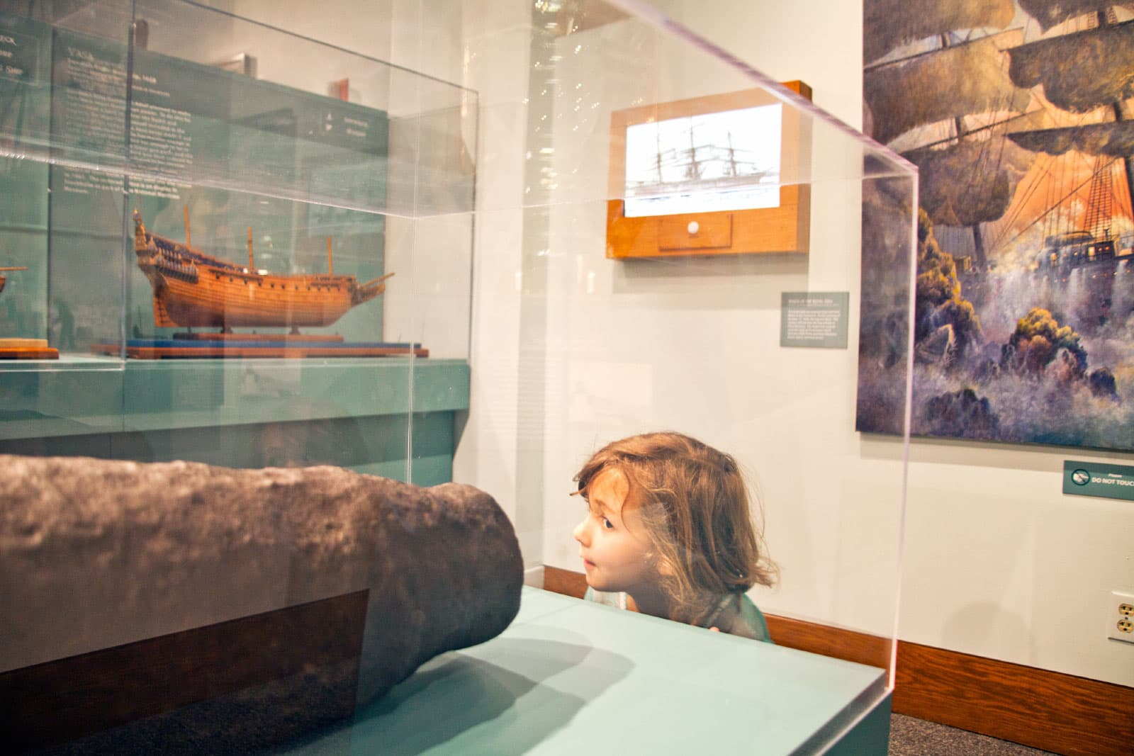 Child looking at Ships of the World exhibit at the San Mateo County History Museum