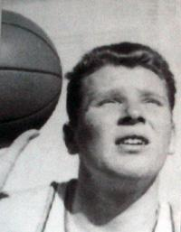A young John Madden in a high school photograph of him playing basketball