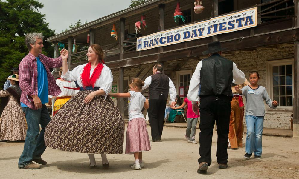 Guests dance in period costumes at the Sanchez Adobe Rancho Day Fiesta