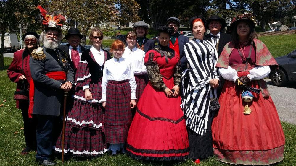 Group dressed in period Victorian clothing for Victorian Walking Day Tours at San Mateo County History Museum