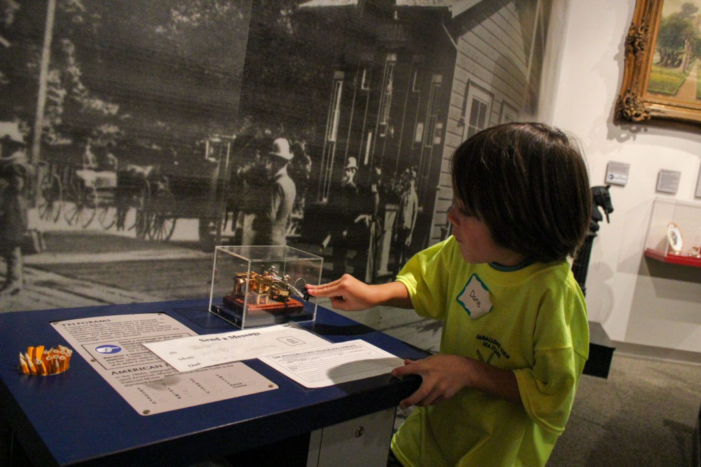 Students send a telegram in the exhibit Journey to Work as part of Getting from Here to There school program at the San Mateo County History Museum
