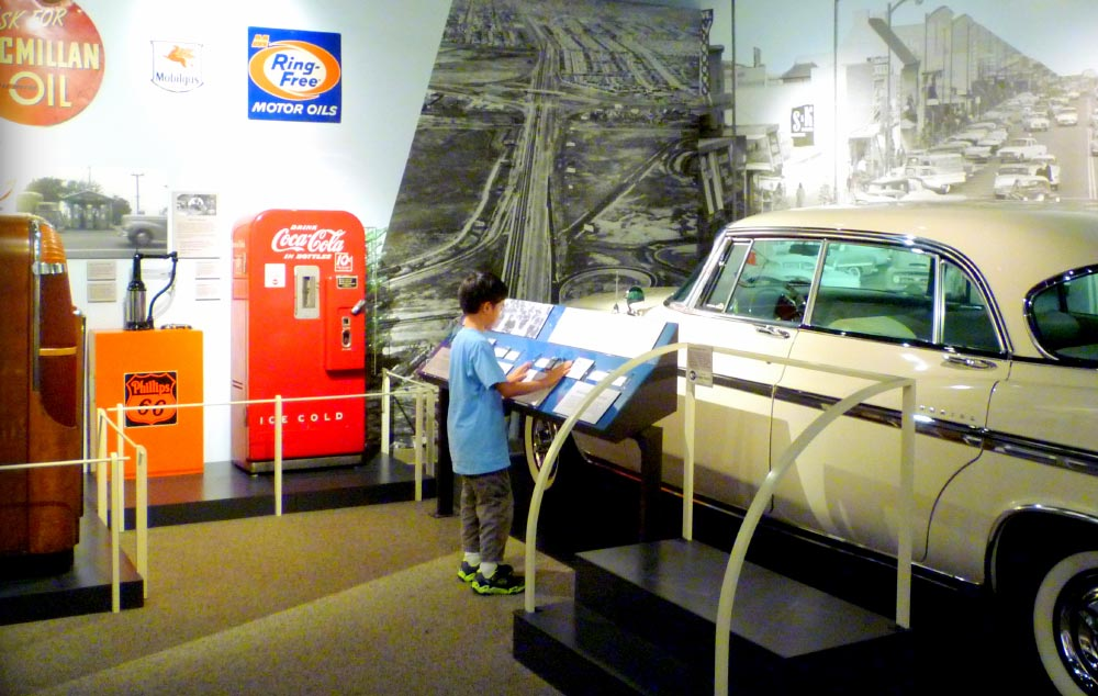 A young boy views a display at Journey to Work at the San Mateo County History Museum