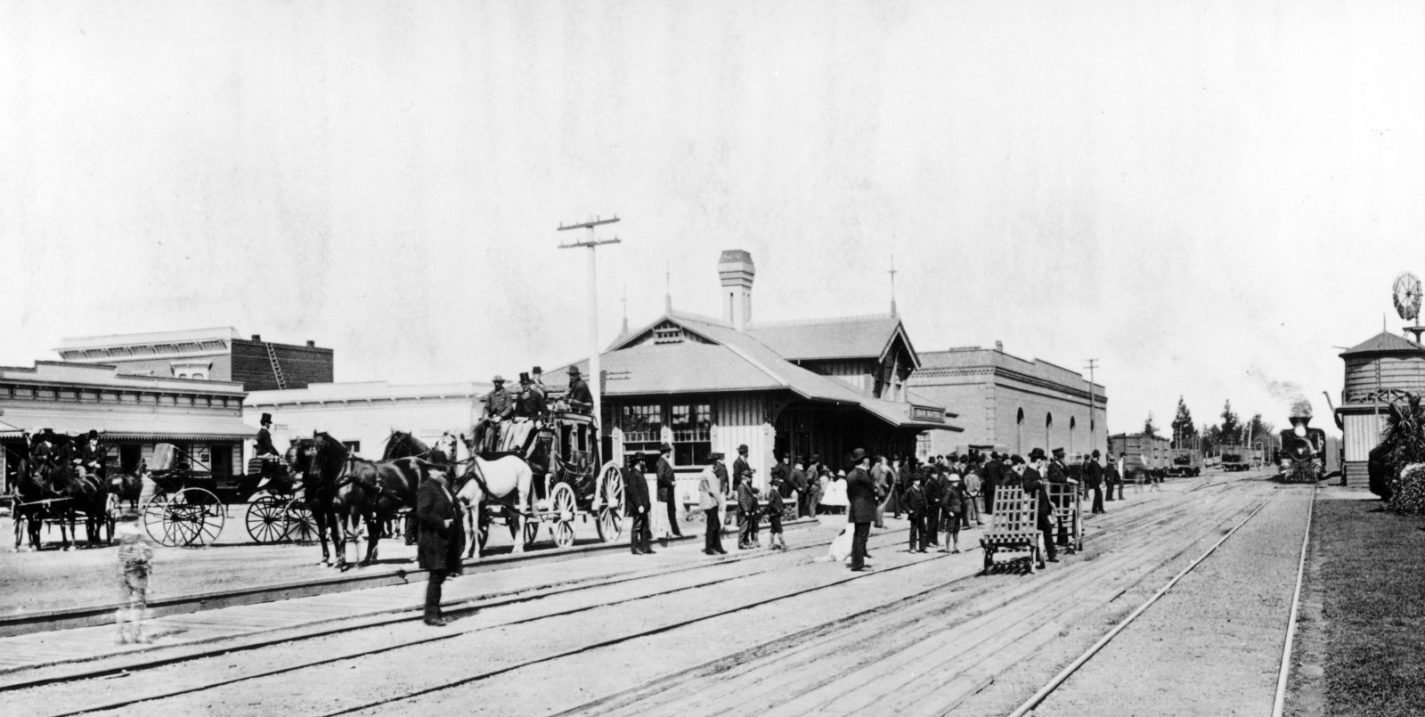 Archival photo of people waiting for train at San Mateo station