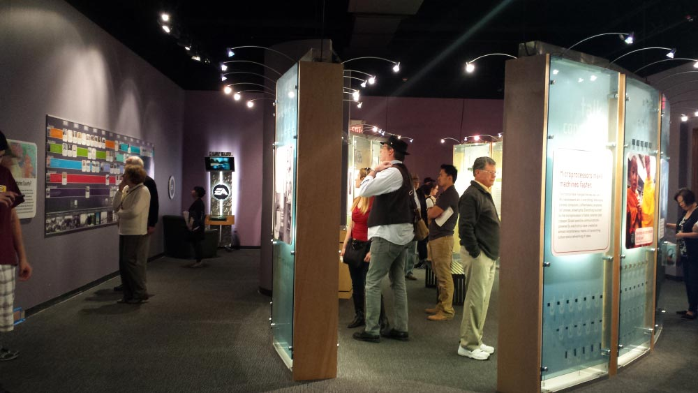Visitors view the exhibit History Makers at the San Mateo County History Museum