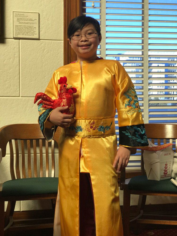 A young boy dressed in traditional Chinese dress for Lunar New Year celebrations at the San Mateo County History Museum