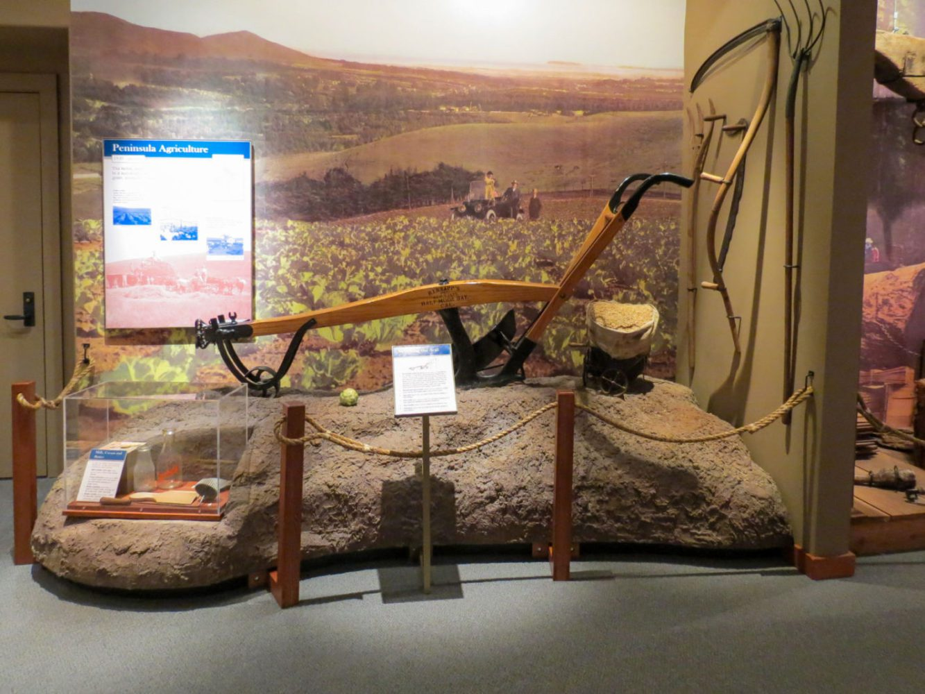 Exhibit display of farming equipment at Natures Bounty at the San Mateo County History Museum