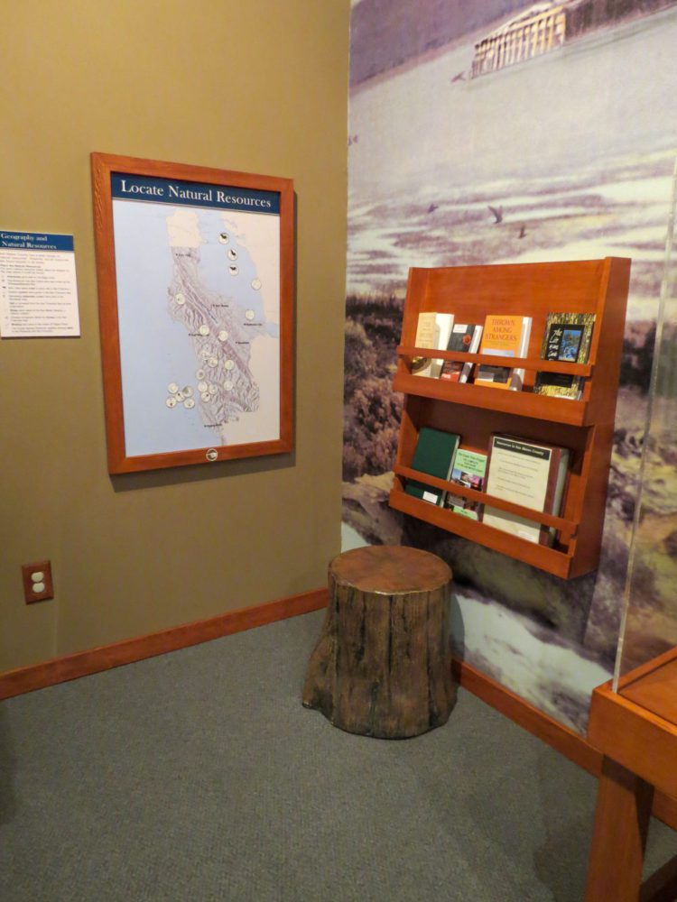 Exhibit display of maps and books at Natures Bounty at the San Mateo County History Museum