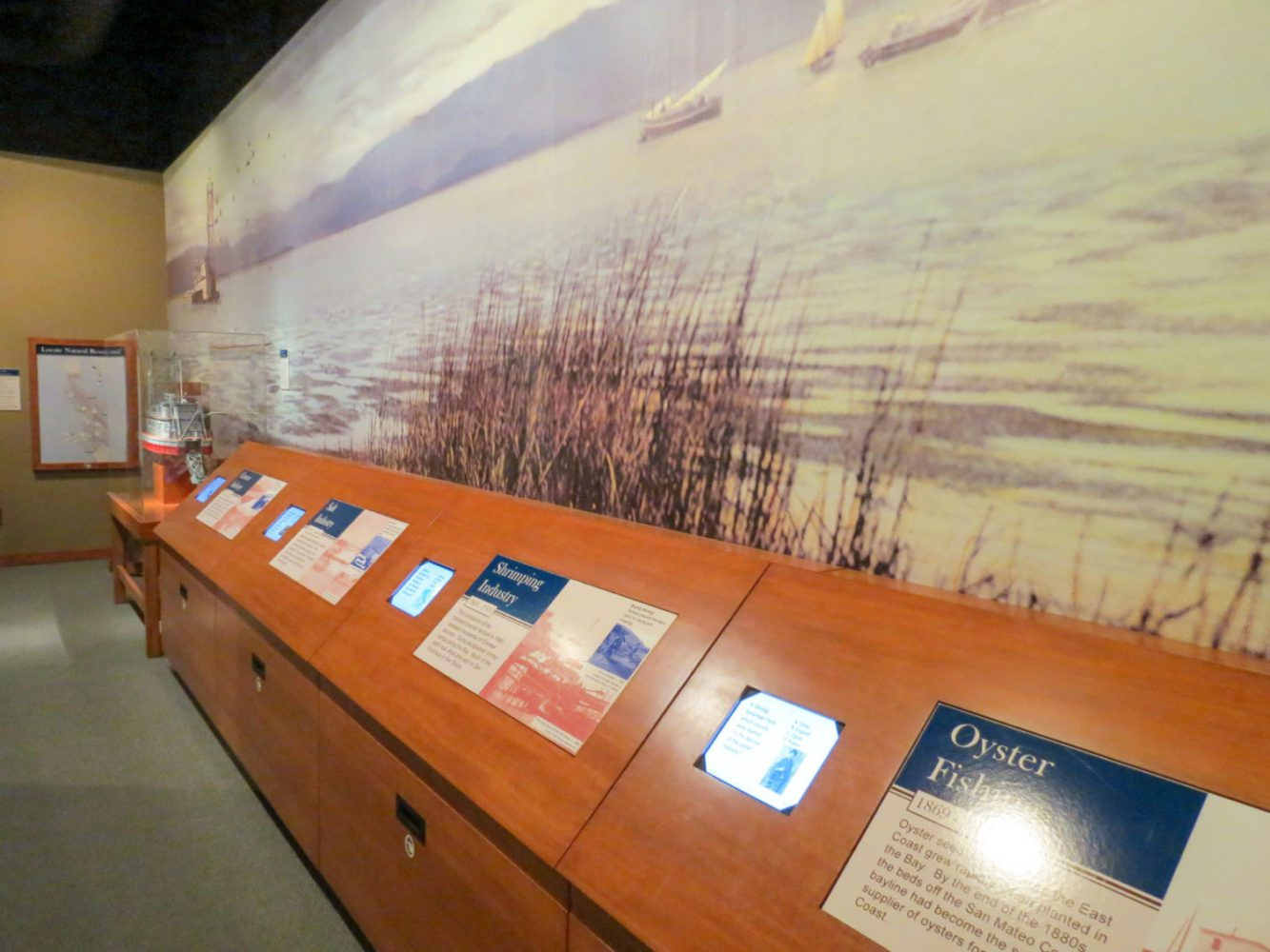 Interactive exhibit display screens at Natures Bounty at the San Mateo County History Museum