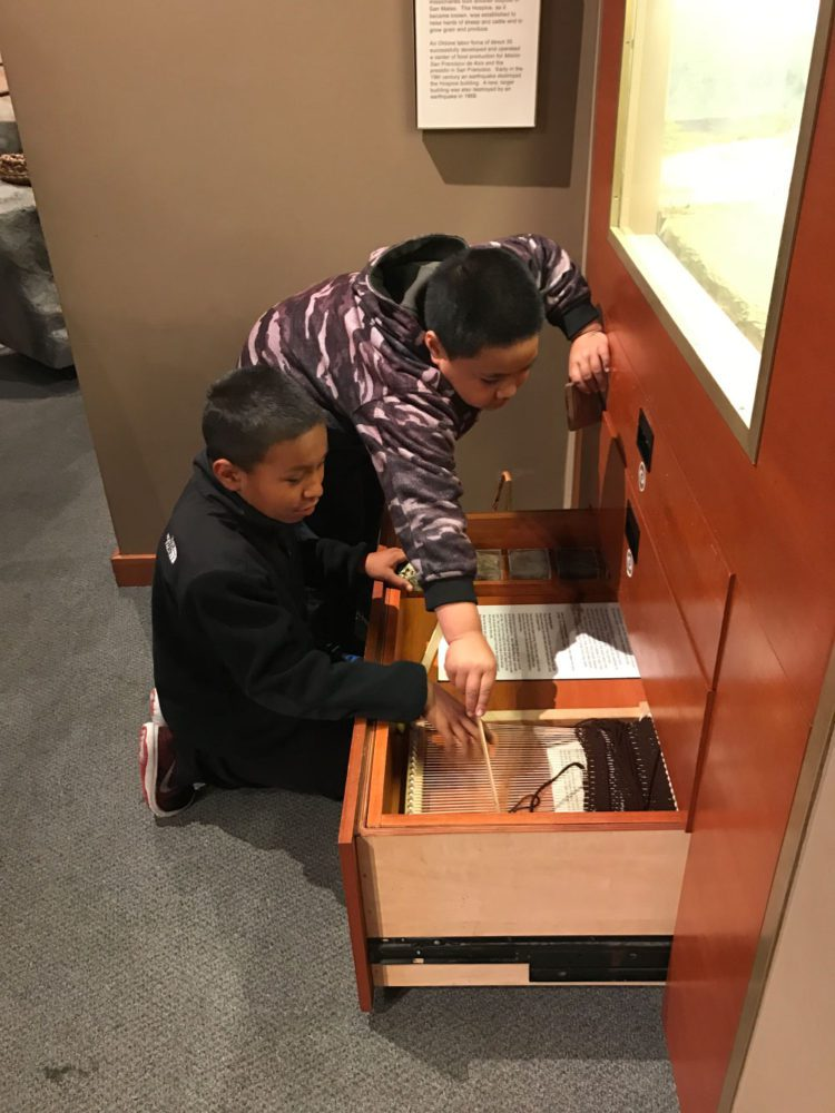 Students explore an interactive display at Providing Plenty school program at the San Mateo County History Museum