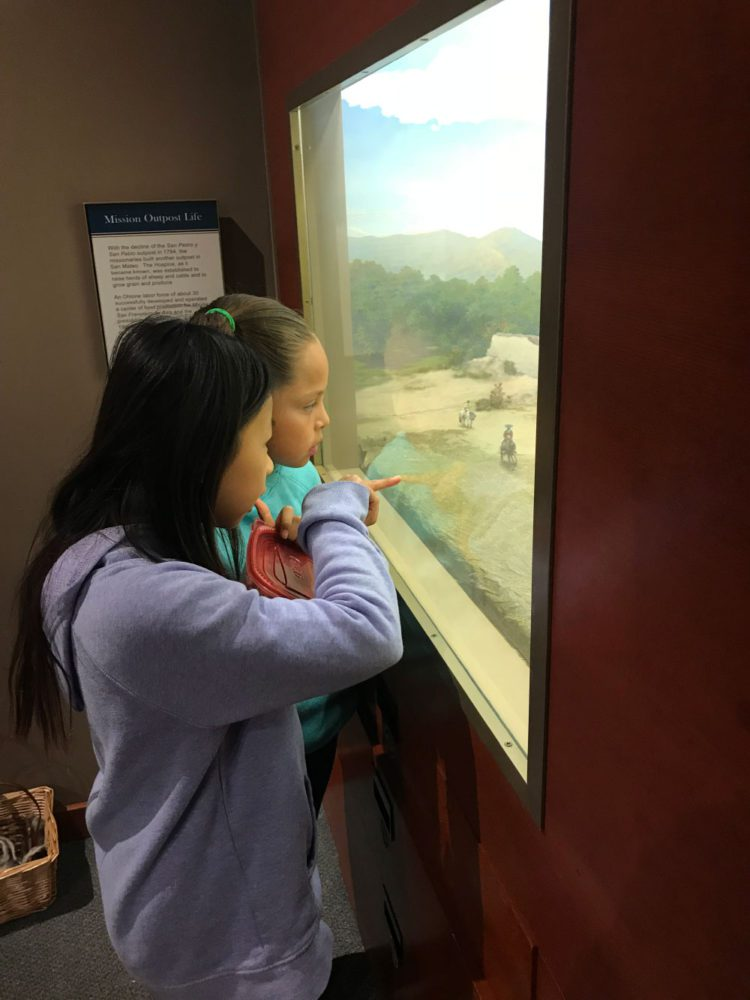 Two students view a display at Providing Plenty school program at the San Mateo County History Museum