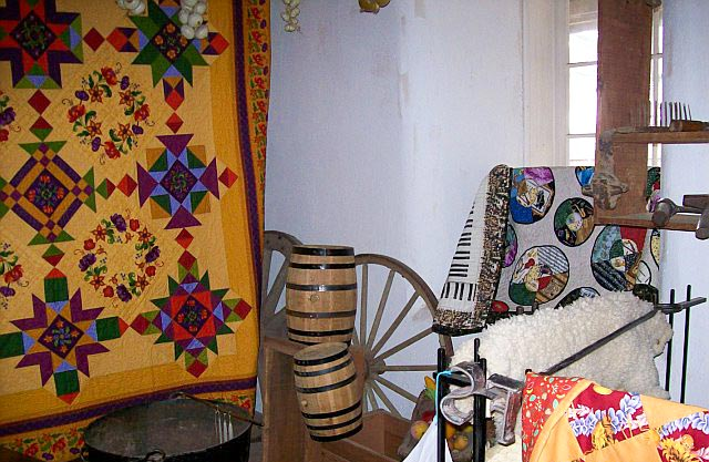 A variety of quilts on display at the Sanchez Adobe Quilt Show