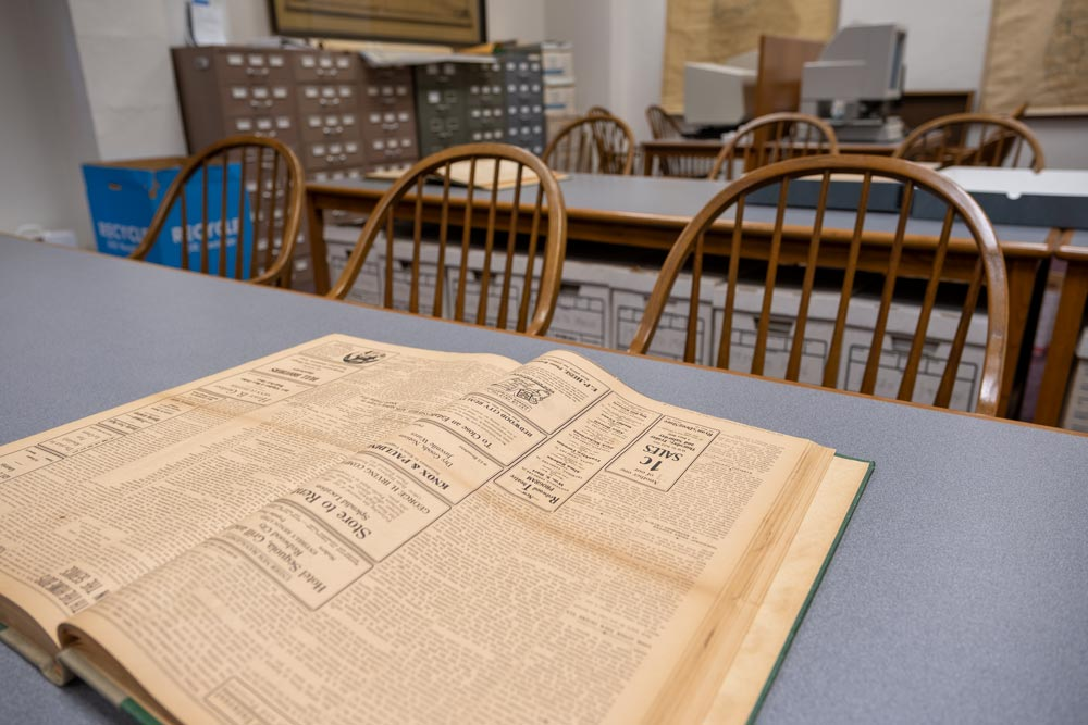 Archives desk at the San Mateo County History Museum with old newspaper articles displayed