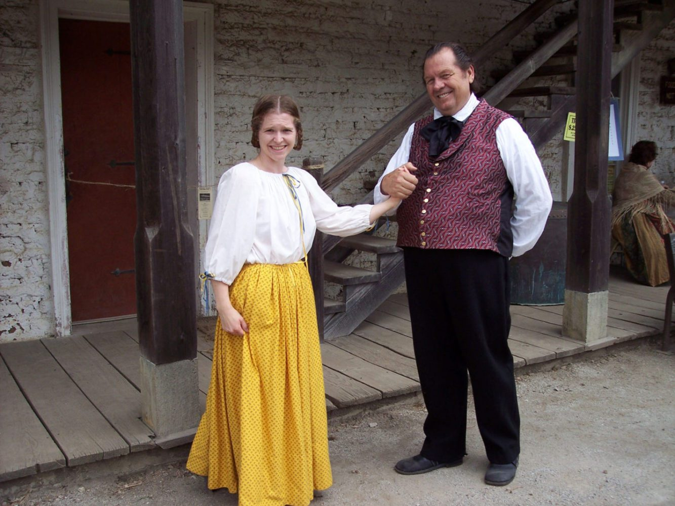 A young woman and man dressed in period costumes at the Sanchez Adobe Rancho Fiesta Day