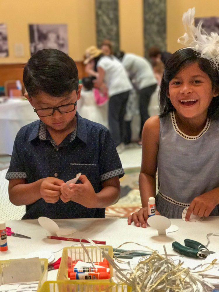 A boy and a girl make a hat craft at Victorian Days at the San Mateo County History Museum