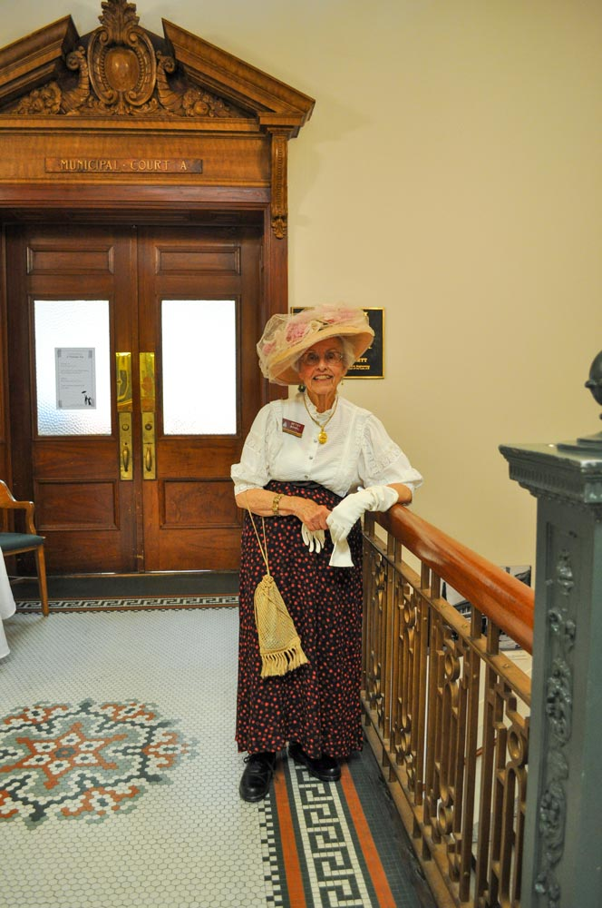 An older woman dressed in Victorian dress at San Mateo County History Museum