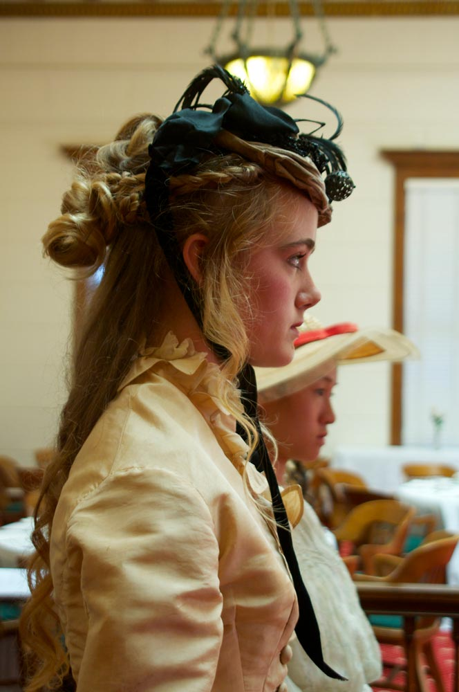 A young woman dressed in Victorian dress at San Mateo County History Museum