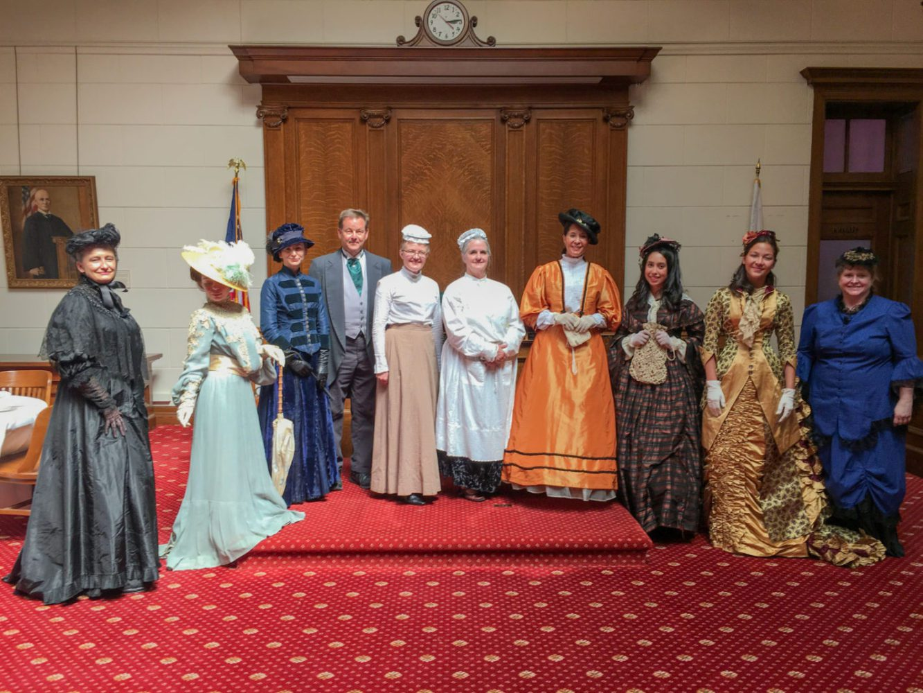 A group of people dressed in Victorian dress at San Mateo County History Museum