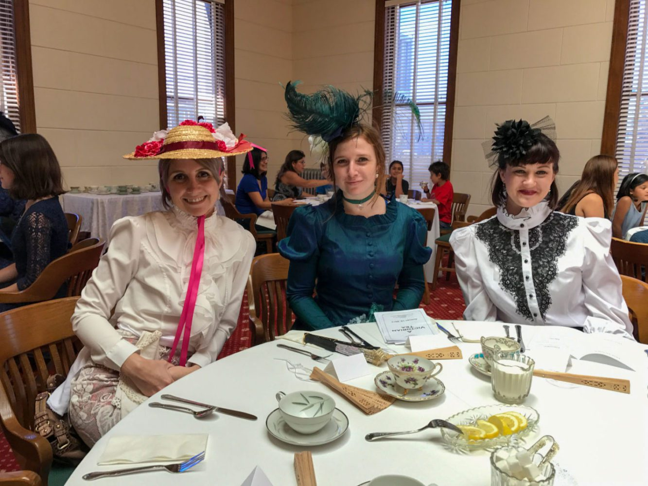 Three women dressed in Victorian dress at San Mateo County History Museum