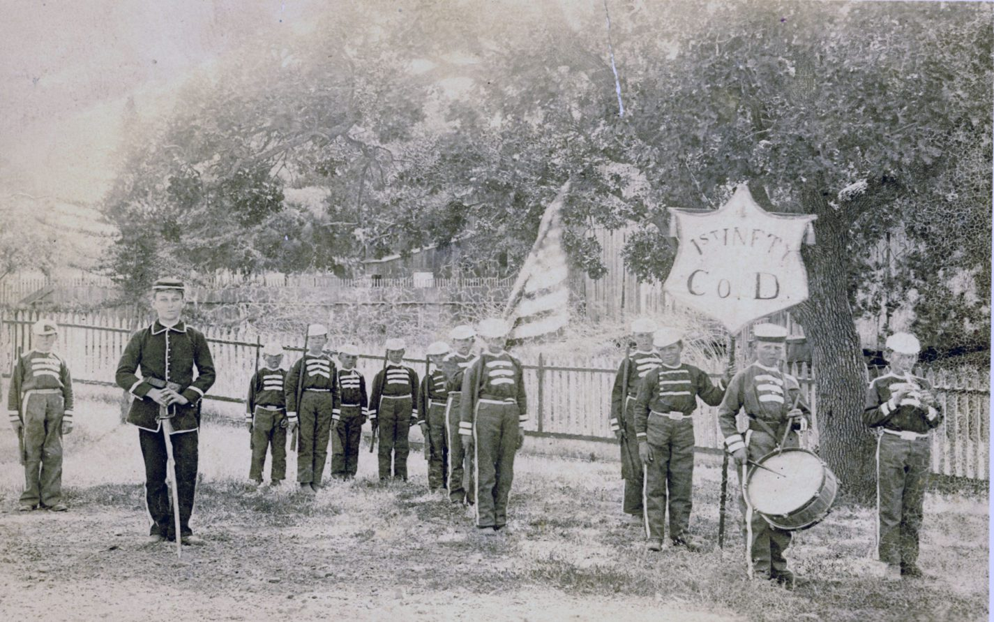 Young boys dressed in uniforms with toy rifle, fife and drum from the First Infantry Company D circa 1880s