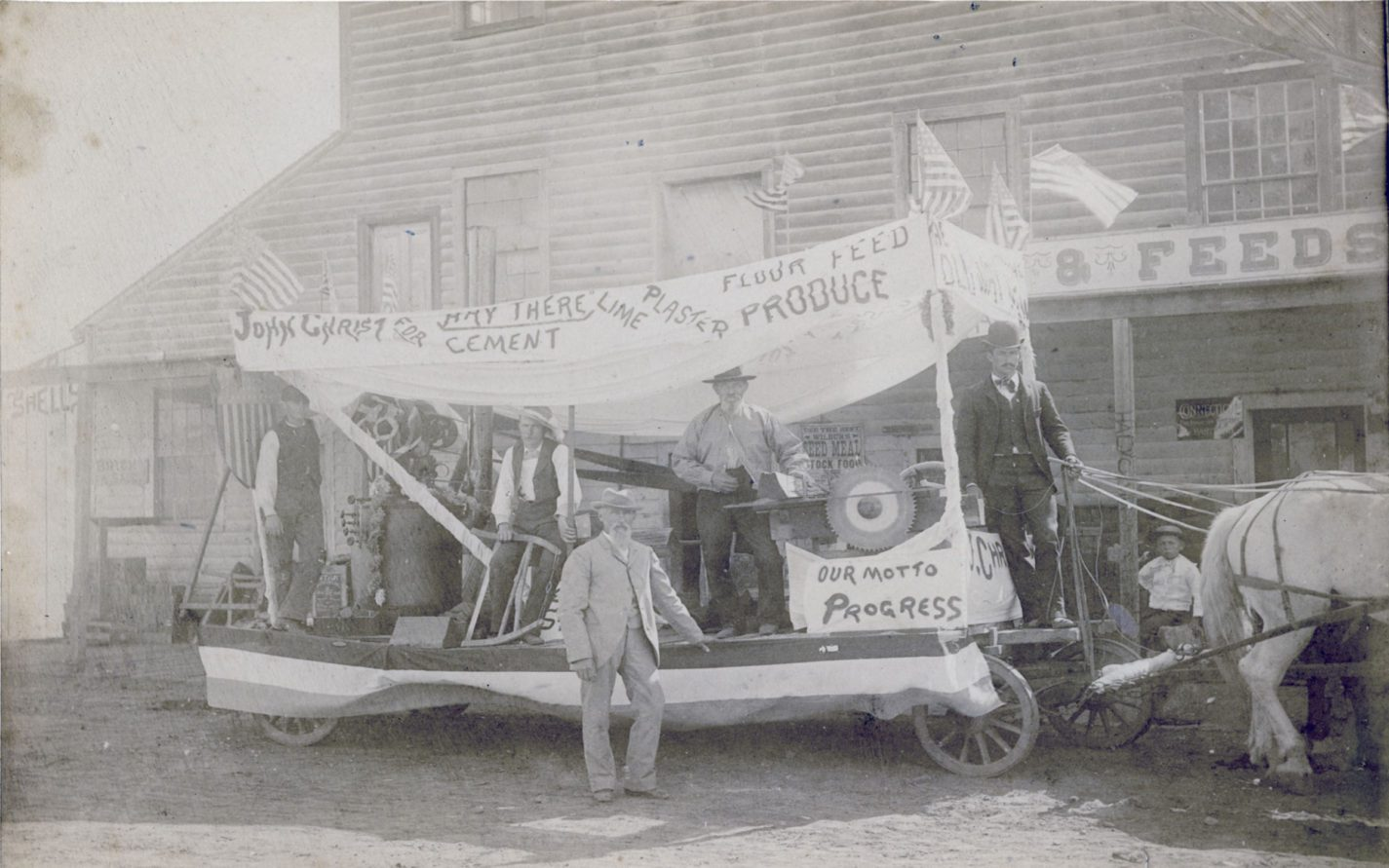 John Christ and his Fourth of July Float advertising his store