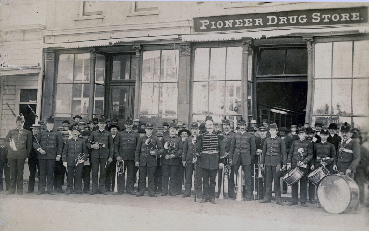 Marching band in front of the Pioneer Drug Store in Redwood City circa 1880s