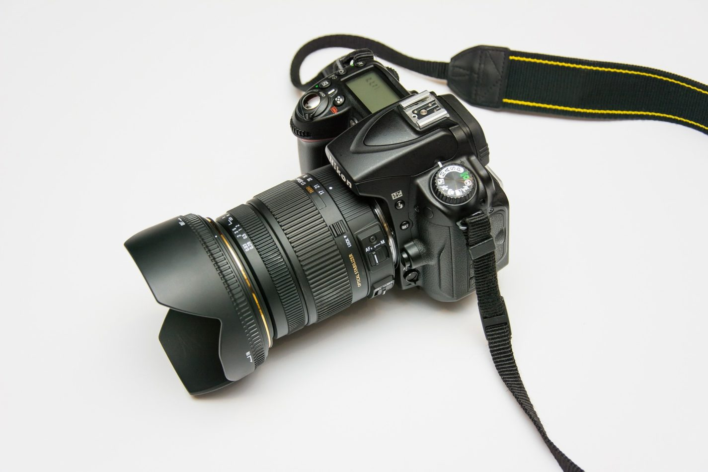 camera with long lens and strap