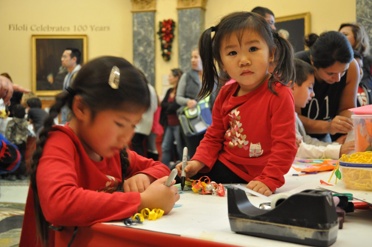 Kids creating a holiday craft at the San Mateo County History Museum