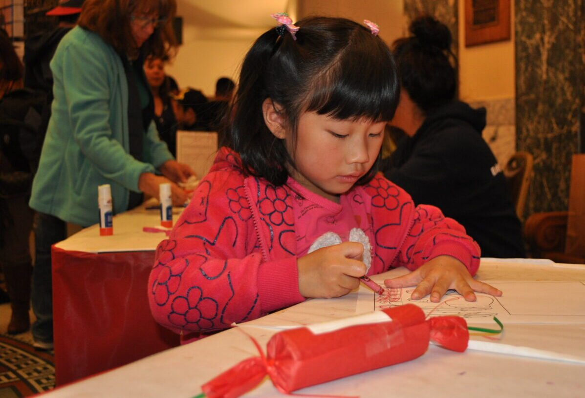 Girl decorating a Christmas cracker