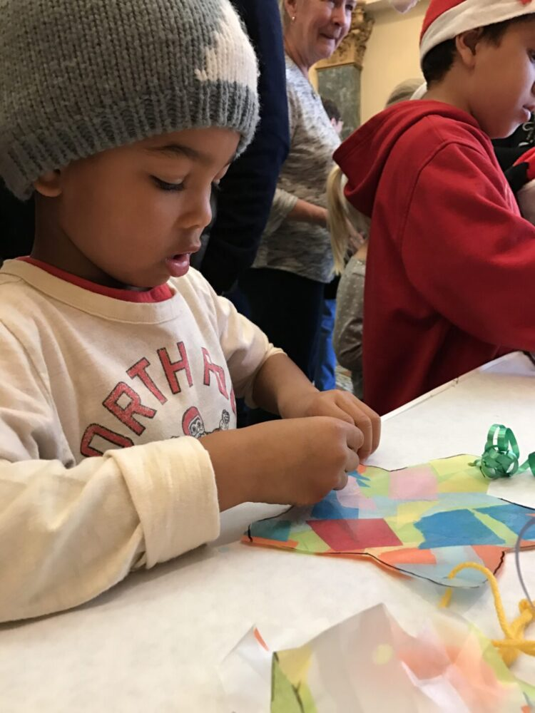 Young boy makes a Filipino parol for the holidays