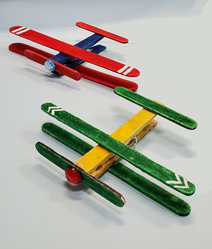 Two clothespin airplanes designed to look like biplanes