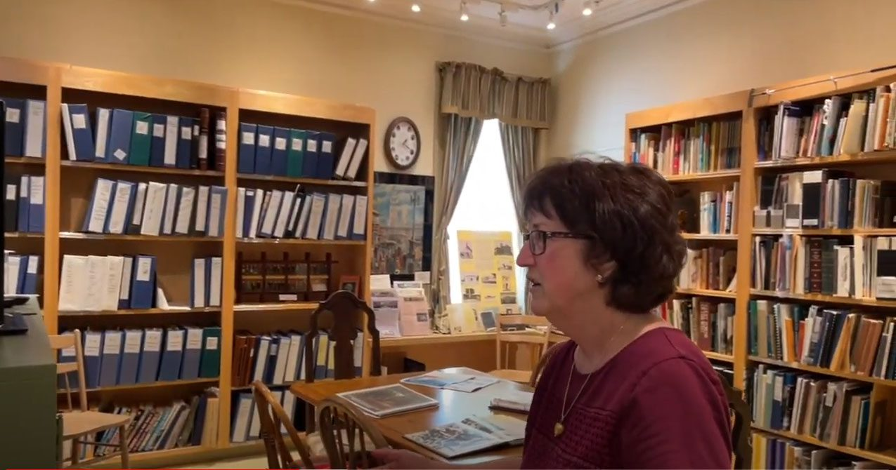 Woman in museum library